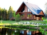 Click to enlarge log home and cottage rentals in front of water. in Ste-Christine D'Auvergne,Quebec