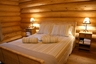 Master bedroom in the Eider log cabin