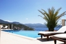 Panoramic view over pool to Meis and islands